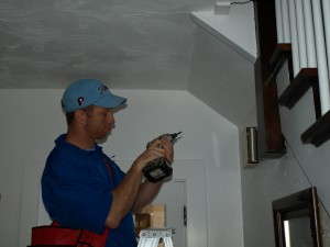 Student from West Virginia University installing a smoke alarm in Morgantown, WV