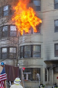 A Suffolk University student was trapped in her fourth-floor apartment by a fire that started in the basement by careless disposal of linseed oil rags.  She was rescued by Brookline fire fighters.
